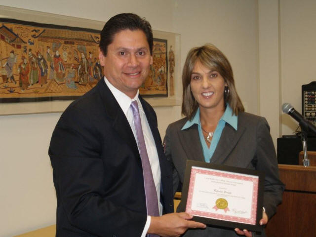 City Auditor Laura Doud receives Distinguished Alumni Award from Long Beach City College Superintendent